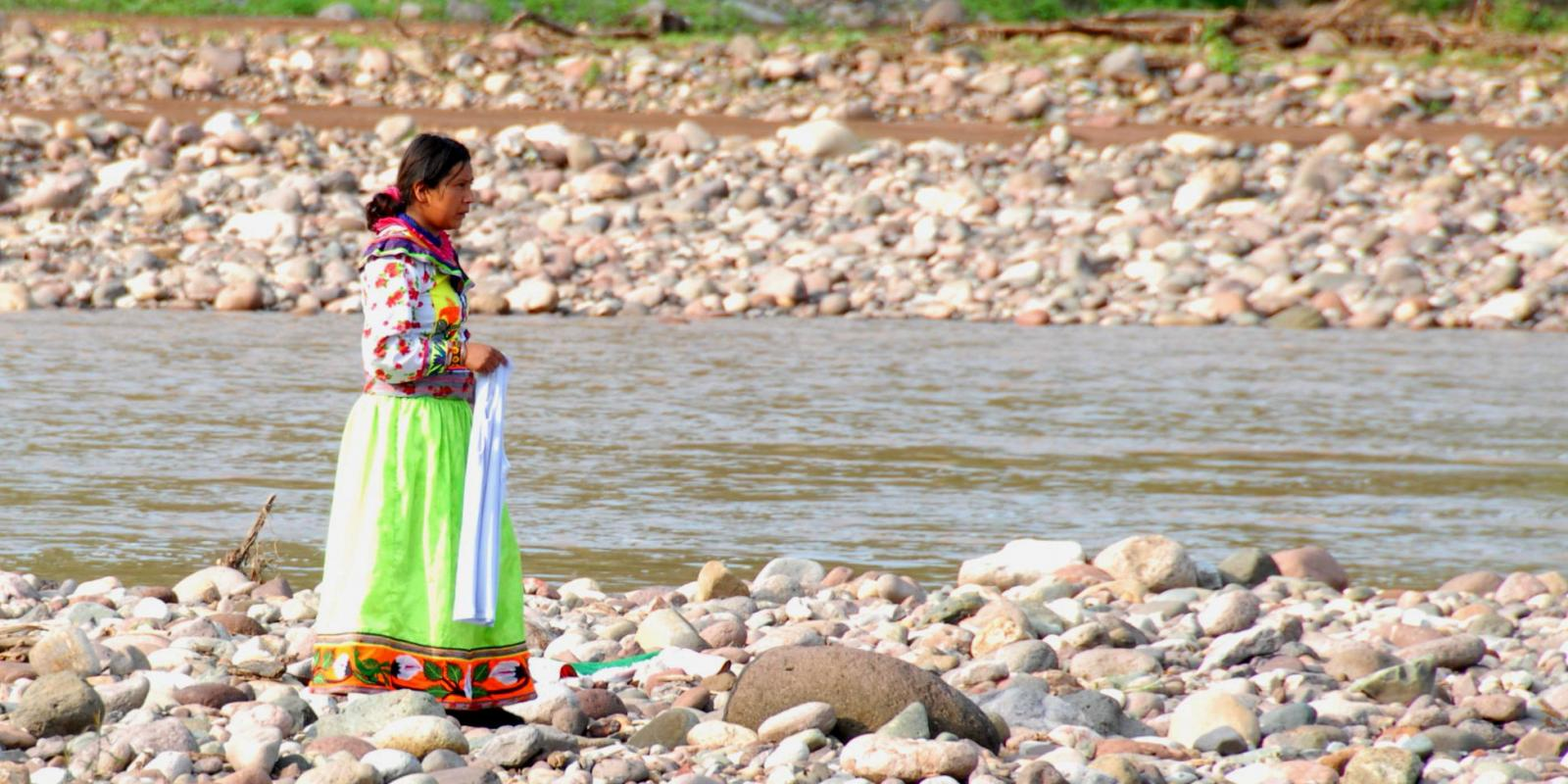 Indigenous woman beside the river.