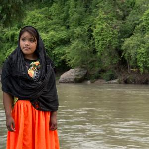 young indigenous woman beside a river