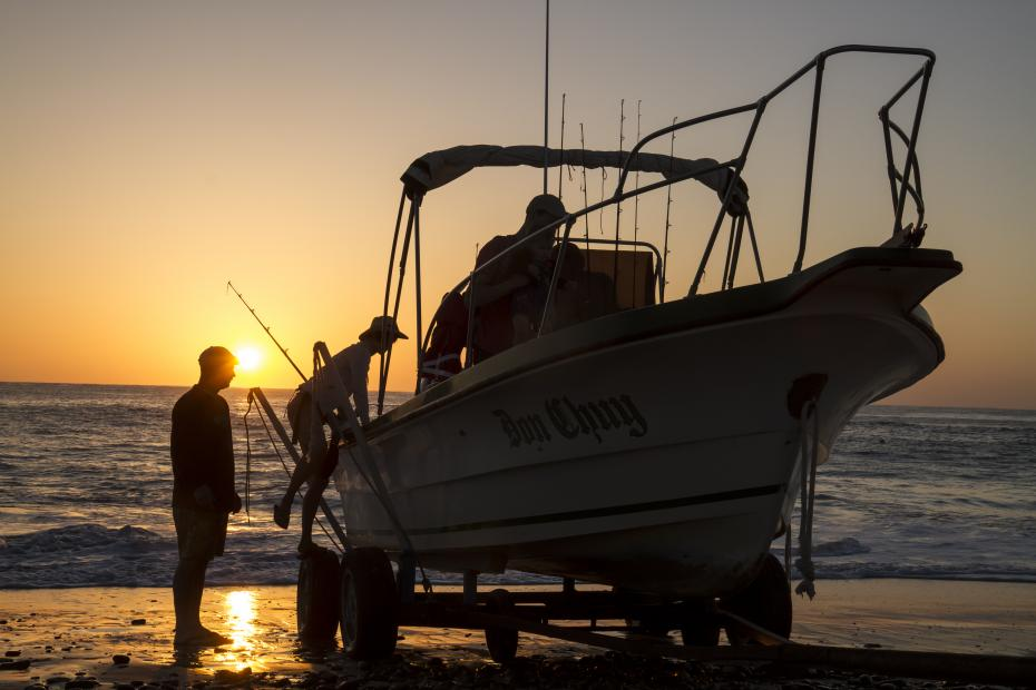 fishermen loading a boat at sunrise
