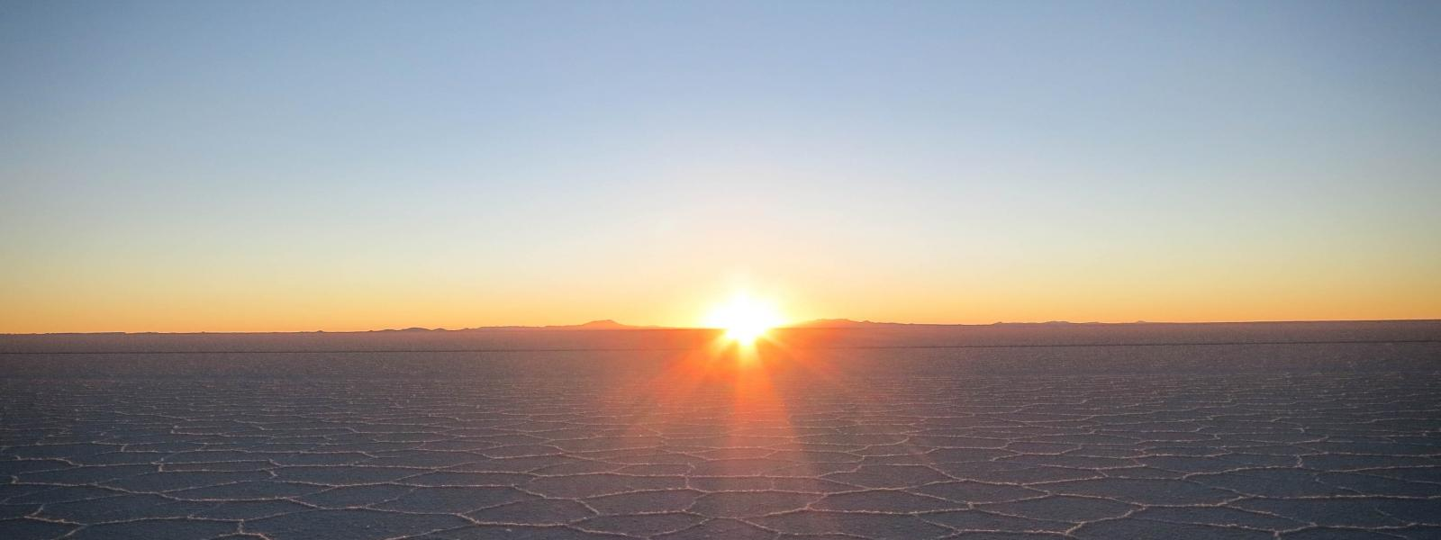 sun rising over the salt flats in Bolivia.