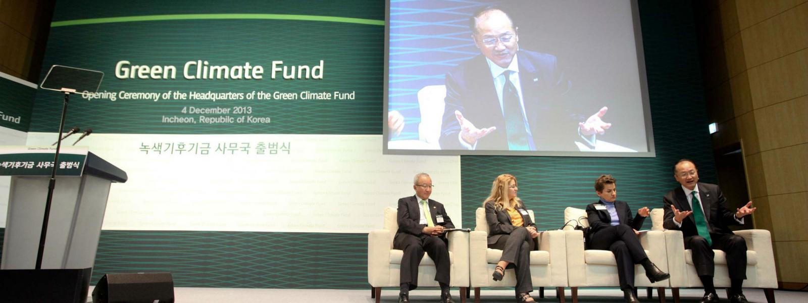 Representatives on stage at a meeting of Green Climate Fund in Songdo, South Korea